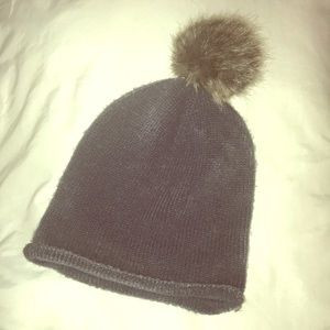 Soft knitted grey H&M hat with fur ball on top